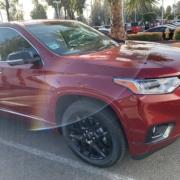 2020-chevrolet-traverse-premier-auto-broker-near-me-torrance-red-black-wheels-in-drive-way